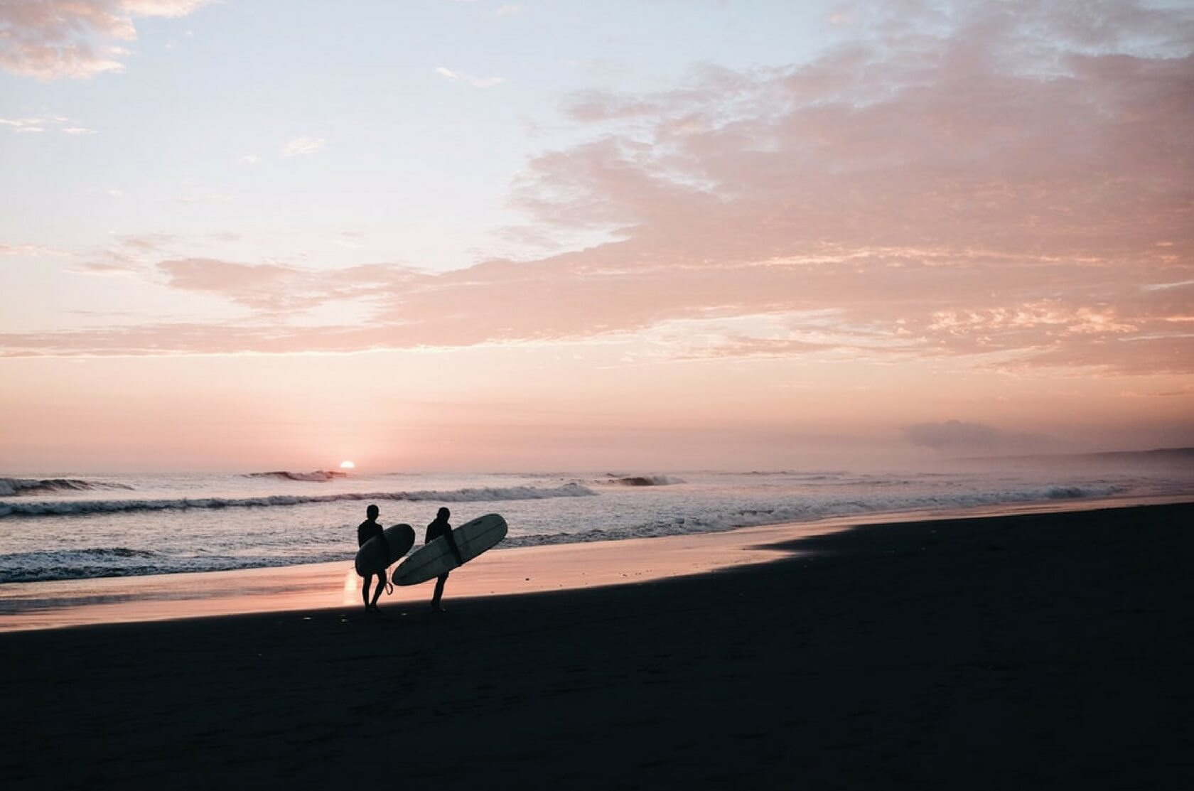 Independent filmmakers have artistic freedom. Surfers on the beach.